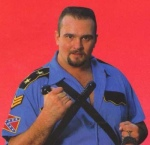 "Big Boss Man- Southern Redneck police character with confederate patch on his shirt. Used baton to beat ""lawbreakers"""