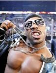 CrymeTyme- Urban rapper character with fake fronts and chains. SMH