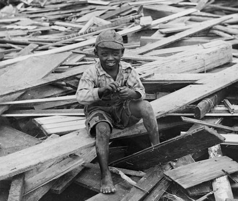 Young child in the aftermath of a hurricane. Circa 1900 Galveston Texas